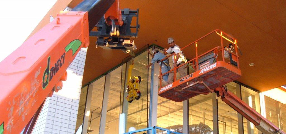 Men on a lift installing new windows from Victorville Glass Company Inc. in Victorville, CA