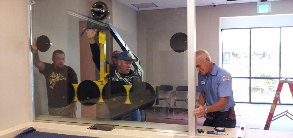 Workers from Victorville Glass Company Inc. in Victorville, CA completing window installations