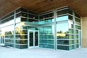 The entryway to a commercial building with new windows installed by Victorville Glass Company Inc. in Victorville, CA